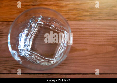 Top View Of An Empty Whiskey Glass On Wooden Table. Healthy Living And Detox Concept. Abstinence, Alcoholism Treatment. New Year's Resolutions. Becomi - Stock Photo