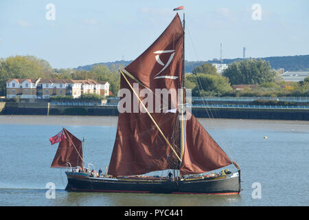 Traditional Thames Sailing Barge seen operating on the River Thames under sail - Stock Photo