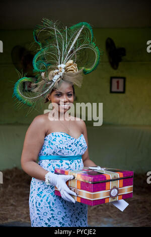 Race day fashion at Champ de Mars Racecourse in Port Louis, Mauritius. - Stock Photo