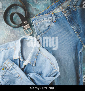 Total denim look. Blue jacket, jeans and black. Flat lay photo fashionable men's clothes - Stock Photo