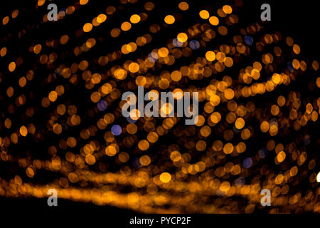 Defocused scene in the night. Garland on a city street at night. Bokeh texture - Stock Photo