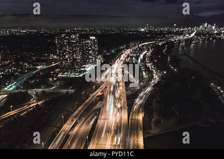 Aerial view from drone above busy highway at night, Toronto, Canada - Stock Photo