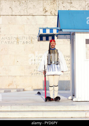 ATHENS, GREECE - AUGUST 15th 2018:   Evzoni Guard, Greek presidential Guardian in front of the Greek parliament building on Syntagma square - Stock Photo