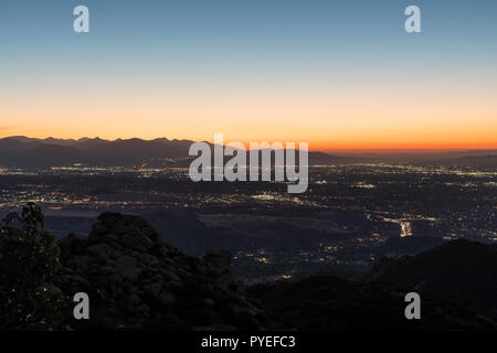 Predawn mountaintop cityscape view of the San Fernando Valley in Los Angeles California.  Shot from Rocky Peak Park near Simi Valley. - Stock Photo