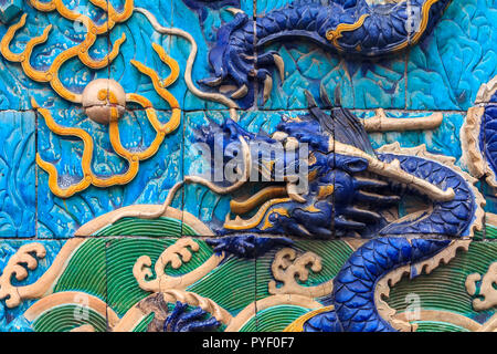 Detail of the Nine Dragon Wall of marble carving of dragons playing with pearls at the Forbidden City palace of the emperors in Beijing, China - Stock Photo