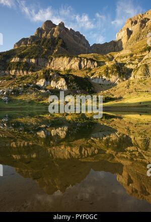 Morning Light and still waters at Ibon de Piedrafita - Stock Photo