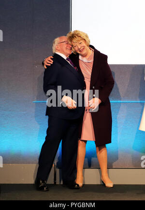 Dublin. 28th Oct, 2018. Irish President Michael D. Higgins hugs his wife Sabina Coyne after he was re-elected as the president in Dublin, Ireland, on Oct. 27, 2018. Michael D. Higgins has been re-elected as the president of Ireland in the country's 2018 presidential election, announced Barry Ryan, Returning Officer of Presidential Election and Referendum Office here on Saturday night. Credit: Xinhua/Alamy Live News - Stock Photo