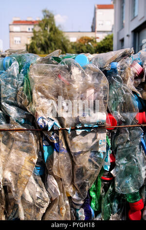Plastic bottles on pile, ready to get recycled. Recycling of old plastic bottles. Pile of packed and recycling ready plastic bottles. Recycling. - Stock Photo