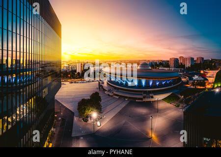KATOWICE, POLAND - SEPTEMBER 18, 2018: Epic sunset over modern city center of Katowice with the famous Spodek sports hall - Stock Photo