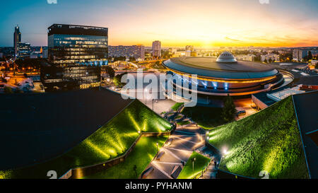 KATOWICE, POLAND - SEPTEMBER 18, 2018: The modern city center of Katowice with green roof of International Congress Centre and the famous Spodek sport - Stock Photo