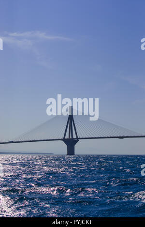 the Rio Antirio bridge or Charilaos Trikoupis bridge, one of the longest cable - stayed bridges of the world, crosses the Gulf of Corinth and linking  - Stock Photo