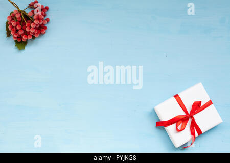 Christmas background with gifts and Christmas tree tea cup fruit - Stock Photo