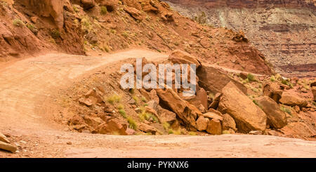 Curving off road trail by the cliffs in Moab Utah - Stock Photo