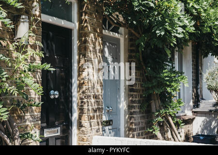 Close up of wooden doors of a traditional Victorian house in Barnes, London, UK. - Stock Photo