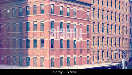 Vintage stylized picture of old brick buildings in downtown New York, USA. - Stock Photo