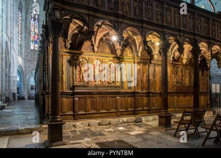 Wooden chancel screen / rood screen of the Cathédrale Notre-Dame de Saint-Bertrand-de-Comminges cathedral, Haute-Garonne, Pyrenees, France - Stock Photo