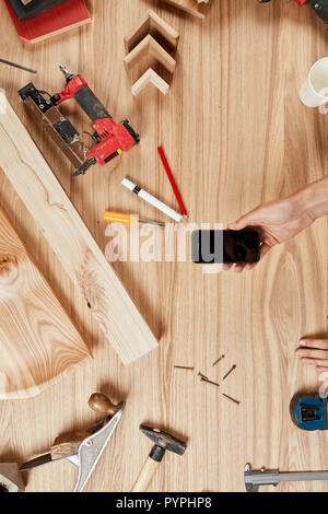 Set of carpenter s tools on wooden background - Stock Photo