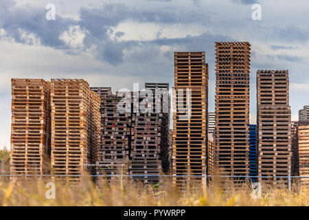 Stacked Wooden Euro Pallets at Storage area of Recycling Depot Warehouse - Stock Photo