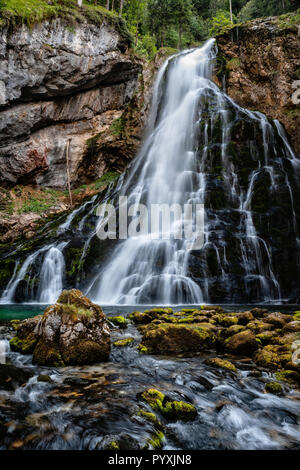 Beautiful view of famous Gollinger Wasserfall with mossy rocks and green trees, Golling, Salzburger Land, Austria - Stock Photo