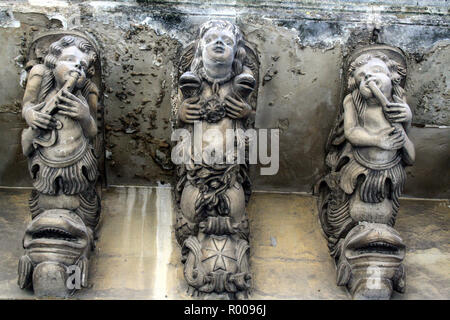 Balcony with typical baroque sculptures in Modica, Sicily, Italy - Stock Photo