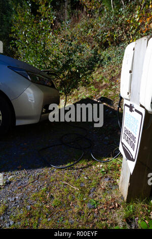 Nissan Leaf 2018 charging at a National Trust Wales free electric car charging station in Penrhyn Castle, Bangor, North Wales - Stock Photo