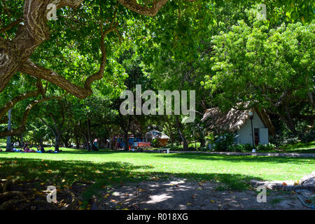 Park with little huts in caribbean sea - Stock Photo
