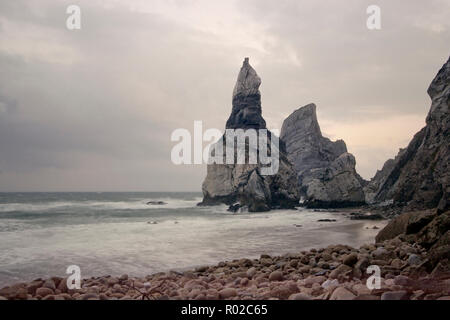 Praia da Ursa; bear beach; before the stone that gave it its name has lost its head. Before storm at dusk. Portugal - Stock Photo