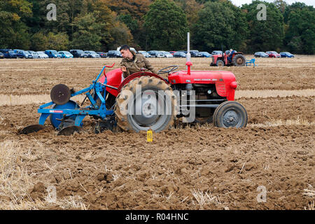 Classic tractors at a ploughing match during the 2018 Skeyton Trosh event in Norfolk. - Stock Photo