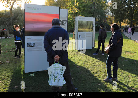 St James's Park, London, UK, 2nd Nov 2018. People look at the exhibits. Fields of Battle - Lands of Peace 14-18 is a powerful outdoor photographic exhibition, by Michael St Maur Sheil, which has toured the country. To mark the closing year of the First War Centenary, the 2018 exhibition reflects upon the participation of all nations. It is currently installed in St James's Park and runs until Nov 19. Credit: Imageplotter News and Sports/Alamy Live News - Stock Photo