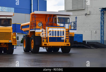 View of the parking lot of an exhibition of large career heavy dump trucks at the automobile plant Belaz in the Republic of Belarus. Zhodino . - Stock Photo