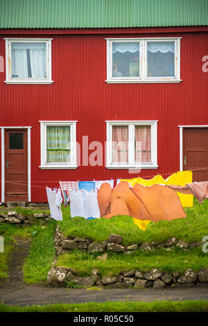 Laundry hanging out to dry in the yard of traditional house, Mykines island, Faroe Islands, Denmark - Stock Photo