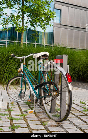 Old bycicle, left behind - Stock Photo