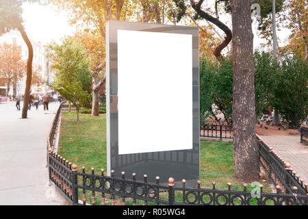 Blank billboard mock up in a park - Stock Photo