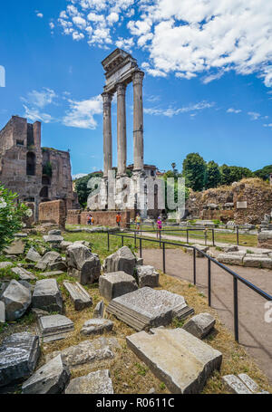 the three remaining Corinthian columns of the ruins of the Temple of Castor and Pollux at the Roman Forum, Rome, Italy - Stock Photo