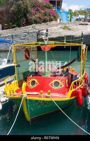 Colourful fishing boat in harbour, Agia Galini, Rethimno Region, Crete (Kriti), Greece - Stock Photo