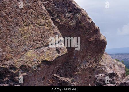 Native American petroglyphs of human figures, Tsankawi mesa cliff-dwellings, New Mexico. Photograph - Stock Photo