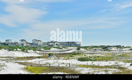 Florida coastal sand dunes landscape looking toward Watersound a coastal living community in the panhandle or Gulf coast of Florida, USA. - Stock Photo