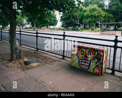 Colourful graffitis in Brighton on a gas meter in the street - Stock Photo