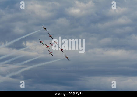 Snowbirds synchronized acrobatic planes performing at air show in Swift Current, Saskatchewan, Canada - Stock Photo