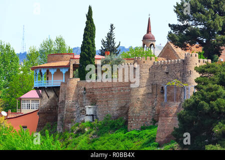 old traditional houses, wall and tower in Old Town of Tbilisi, Georgia - Stock Photo