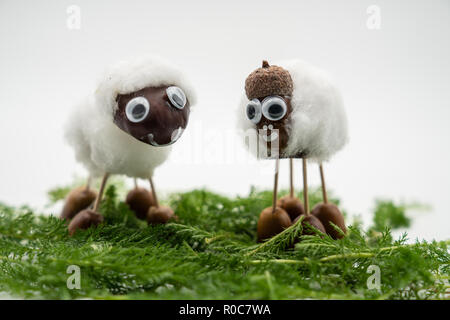 Chestnut figures as sheep against an isolated white background - Stock Photo