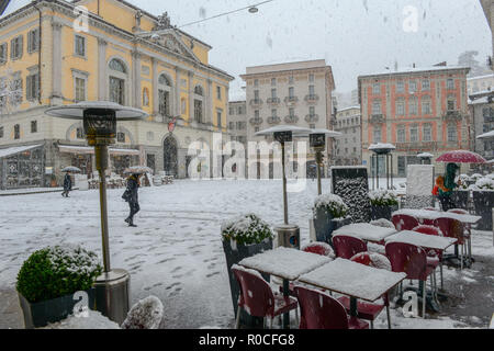 Lugano, Switzerland - 5 March 2016 - main square of Riforma with town hall on snow at Lugano in Switzerland - Stock Photo