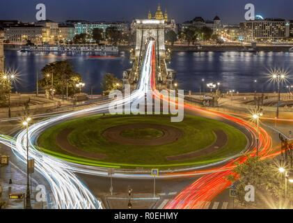 Night aerial view of the Chain Bridge and Danube in Budapest, Hungary, Europe with traffic lights of the city. - Stock Photo