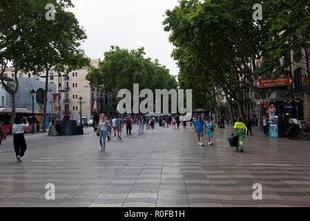 People walking along La Rambla, Barcelona, Spain - Stock Photo