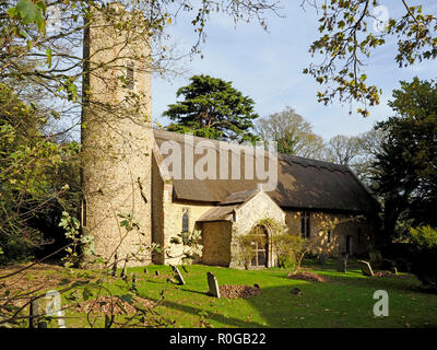 The village church in Horsey, Norfolk is one of many in the county with a round tower rarely found outside East Anglia. - Stock Photo