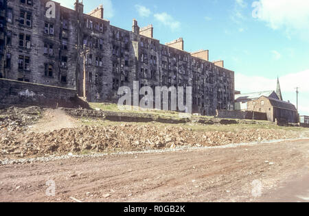 Old tenement blocks in Maryhill, Glasgow awaiting demolition and clearance in April 1977. - Stock Photo