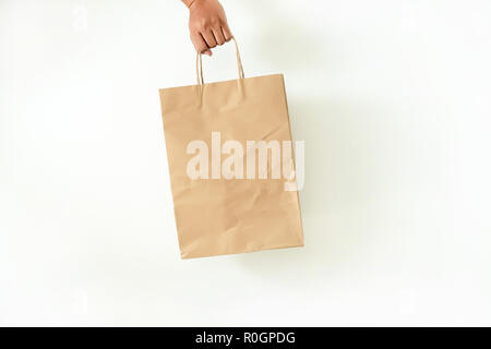 Consumer pack product Man shows bag mock up show - Stock Photo