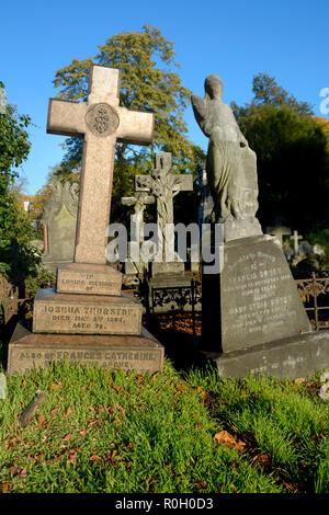 Leaning gravestones in Brompton Cemetery (Kensington and Chelsea) London, England, UK. - Stock Photo