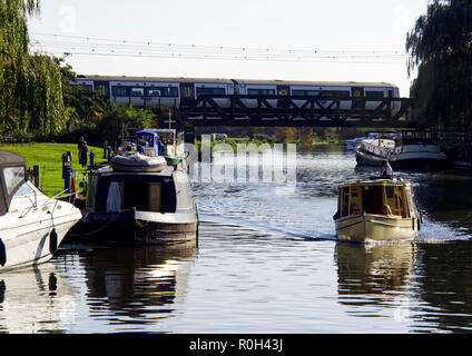 The Great Ouse river flowing through the pretty cathedral town of Ely, Cambridgeshire is popular with boating enthusiasts and barge dwellers. - Stock Photo