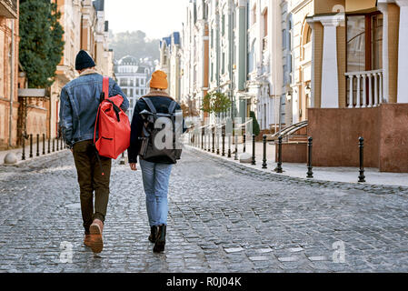 Traveler couple bloggers in love are enjoying view of old city - Stock Photo